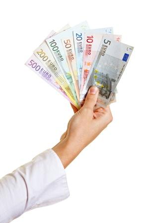 show bill: Mano que sostiene fan coloridas hechas de papel moneda Euro