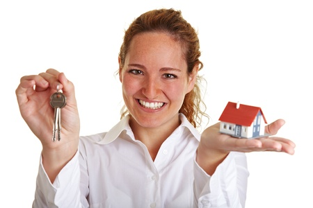 vender: Happy woman with small house and keys