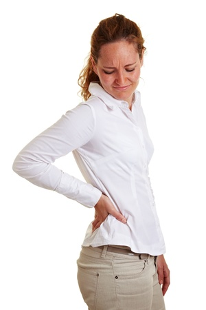 lean back: Business woman with back pain holding her aching hip Stock Photo