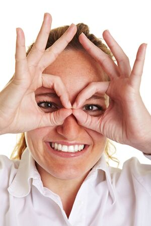 imitations: Happy business woman making circles with her fingers around her eyes