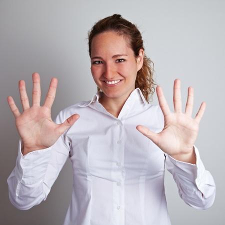 ten empty: Business woman showing her open hands with ten fingers