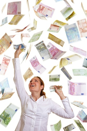 Happy business woman catching falling Euro money Stock Photo - 10175033