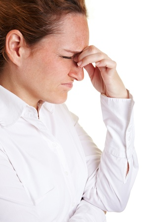 speculate: Business woman with migraine massaging bridge of nose Stock Photo