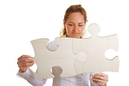 Business woman putting together two oversized jigsaw pieces Stock Photo - 10174941