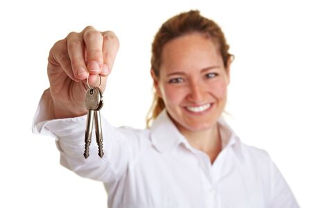 renter: Happy business woman holding two keys in her hand Stock Photo