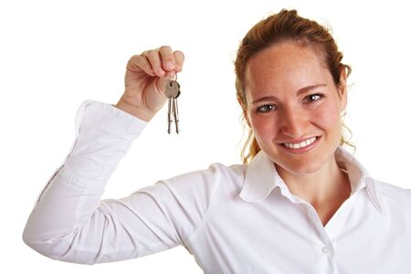 key in chain: Happy business woman showing two keys in her hand Stock Photo
