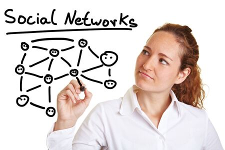 explanations: Business woman explaining social networks with a pen