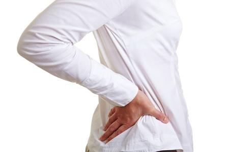 pangs: Donna con il mal di schiena tenendo l'anca dolorante