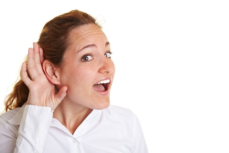 hardness: Business woman eavesdropping with hand behind her ear