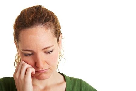 saddened: A young sad pensive woman looking down