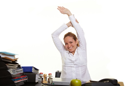 Happy business woman loosen up at her desk at work Stock Photo - 10175021