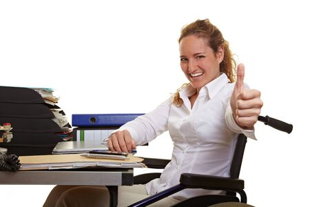 Happy disabled business woman in wheelchair holding thumbs up