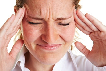 pangs: Business woman with headache massaging her aching temples Stock Photo