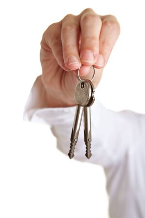 Delivery of two keys in a hand photo