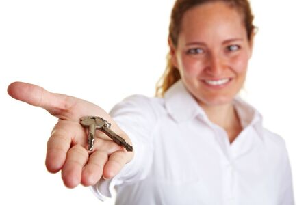 Business woman offering two keys on her open palm photo