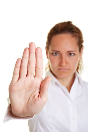 negation: Business woman showing stop sign with her hand Stock Photo