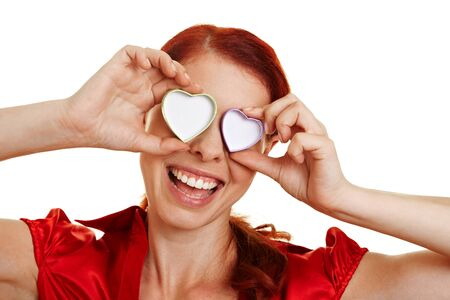 Happy woman in love with hearts in front of her eyes Stock Photo - 10393139