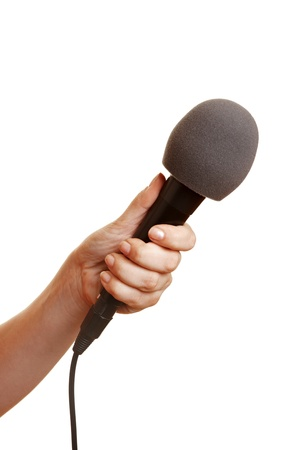 mic: Hand holding a microphone with a windscreen