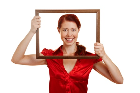 self conceit: Happy woman looking through an empty frame