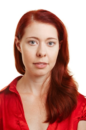frontal: Portrait of a young attractive redhaired woman Stock Photo