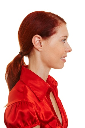 Profile side view of a young redhaired woman Stock Photo - 10427841