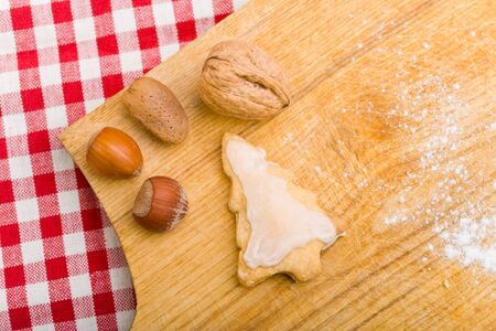 Christmas cookies and nuts on a cutting board Stock Photo - 10427890