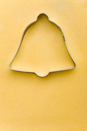cookie cutter: Bell shaped cookie cutter on raw cookie dough Stock Photo