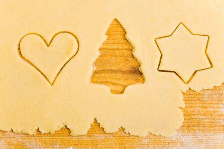 Empty christmas tree shape in a raw dough photo