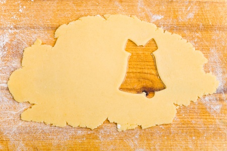 cut outs: Empty bell shape in raw cristmas cookie dough