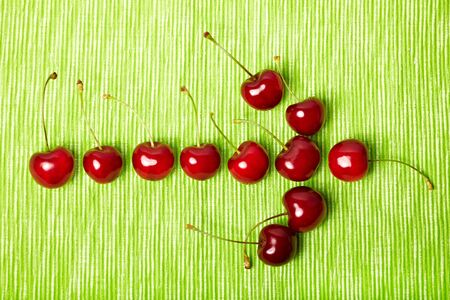 ripeness: Arrow pointing to the right made of red cherries
