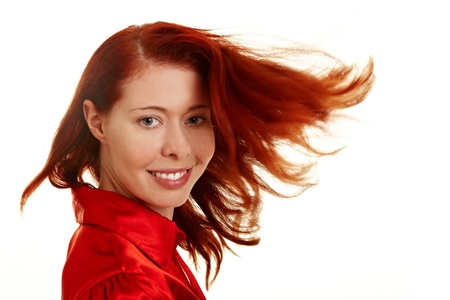redhaired: Young woman letting her long red hair fly Stock Photo