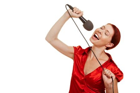 female singer: Happy young woman singing karaoke with microphone