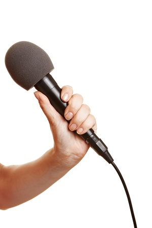 moderation: Hand holding a microphone with a windscreen