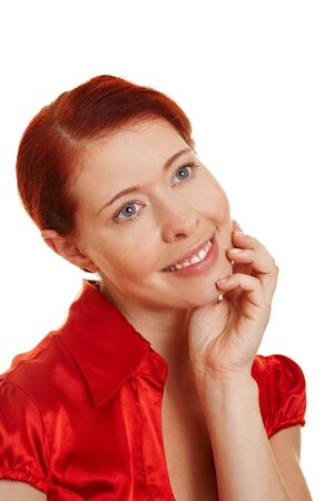 scepticism: Young redhaired pensive woman making a decision Stock Photo