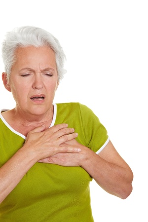 woman chest: Senior woman having a heart attack and grabbing her chest Stock Photo