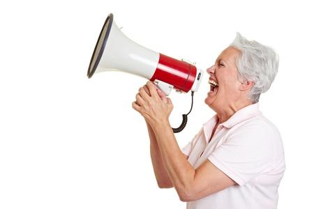 speaking tube: Senior woman screaming loudly in a megaphone
