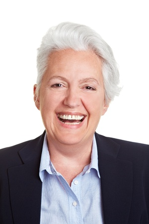 frontal: Frontal head shot of a happy smiling senior woman Stock Photo