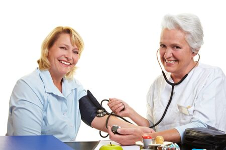 blood circulation: Happy woman getting blood pressure measure at health check Stock Photo
