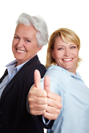 Happy senior mother and adult daughter holding her thumbs up photo