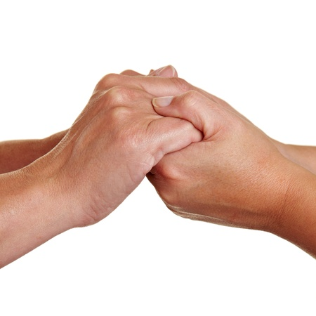 Two people holding hands for condolence photo