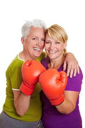 Two happy senior women with red boxing gloves photo