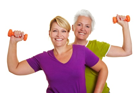 Happy senior women making fitness training with dumbbells photo
