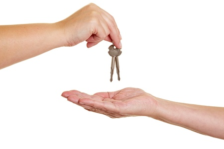 to another: Handover of keys from one hand to another Stock Photo