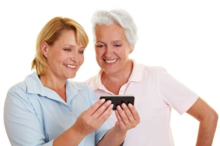 Happy senior woman looking at a smartphone photo