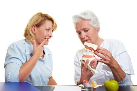 Woman with toothache at dentist showing her teeth Stock Photo - 10582311