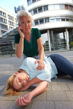 emergency number: Senior woman making emergency call for ambulance Stock Photo