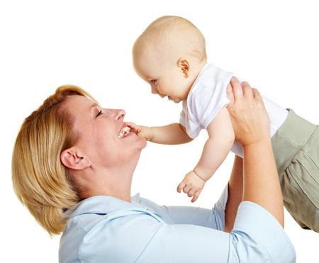 grandmother children: Madre feliz ancianos levantar un beb� sonriente