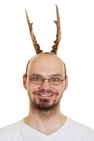 grin: Grining man with antlers on his head