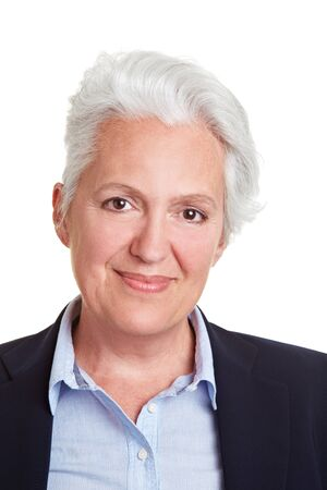 frontal: Head shot of smiling senior woman with grey hair Stock Photo