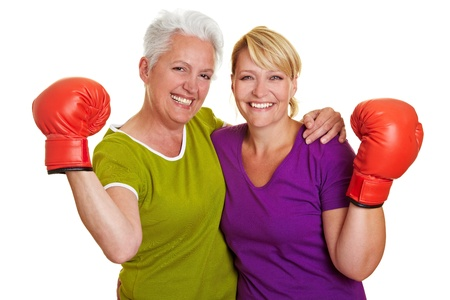 Two active senior women with red boxing gloves photo